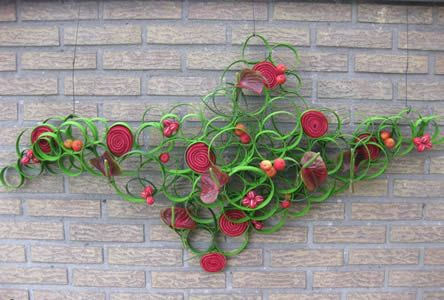 Muurdecoratie maken: bloemschikken voor aparte muurdecoratie zelf maken