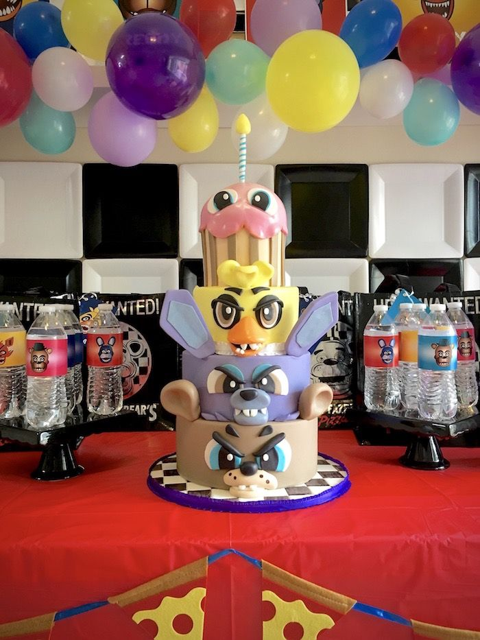 Legit 4-tier cake from Five Nights at Freddy's Birthday Party at Kara's Party Ideas. See more at karaspartyideas.com!