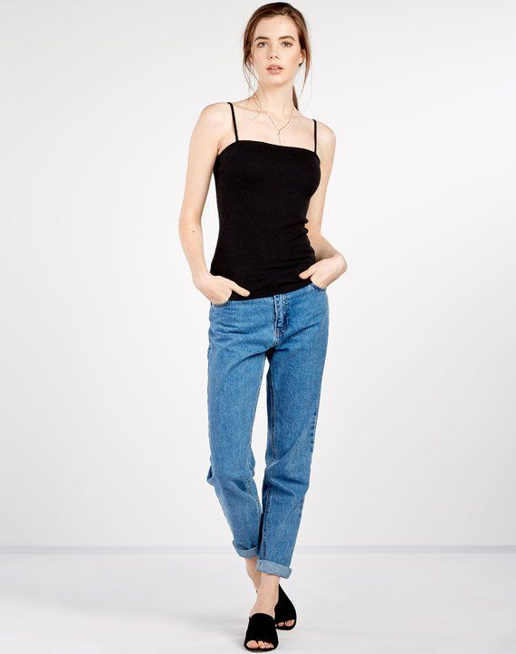 Glassons Rib Bodycon Singlet: Anyone that pays attention to Kendall Jenner and Gigi Hadid knows that this straight-across-neckline is hot. Worn with boyfriend jeans, this look is hot! https://www.finder.com.au/editors-shopping-picks