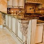 This spectacular Kitchen is an old world design with a fantastic  hand rubbed finish with chimneypiece hood, pop-out  spice racks contained on each side of the