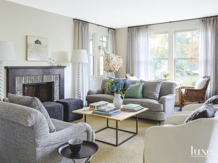 Monochromatic Living Room with Custom Furniture and Fireplace