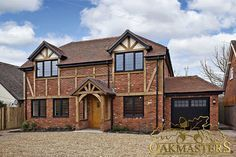 External house cladding - Oakmasters - Oak cladding can be applied directly onto brick walls