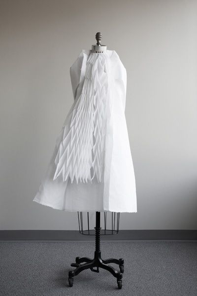 Conceptual fashion/art by Ying Gao white dress fabric manipulation