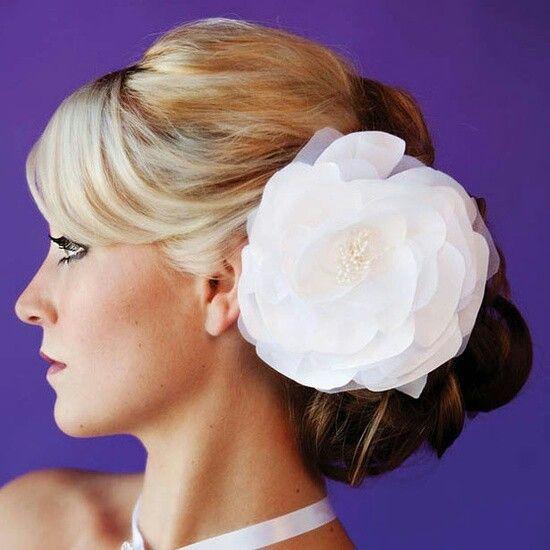 Interesting wedding hairdo.