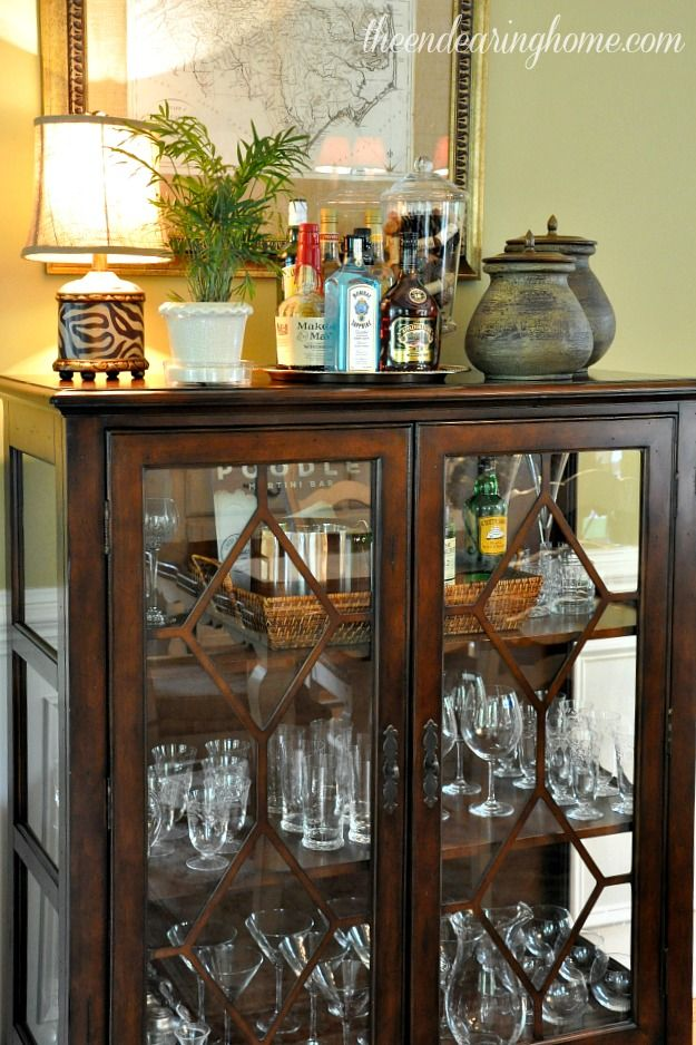 Great Use Of An Antique Curio For A Makeshift Bar Area
