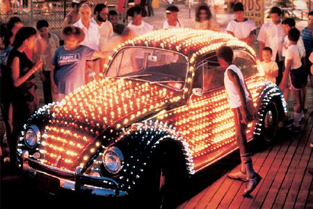 Makes me think of the 1920's in Chicago... but I'm not sure why -Lighted VW Bug covered in 1659 lamps that light the car in 20 different patterns by Eric Staller.