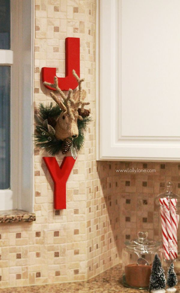 DIY | Adorable JOY Christmas wall decor. Cute way to dress up your kitchen. Click through for cute Christmas kitchen decor ideas.: