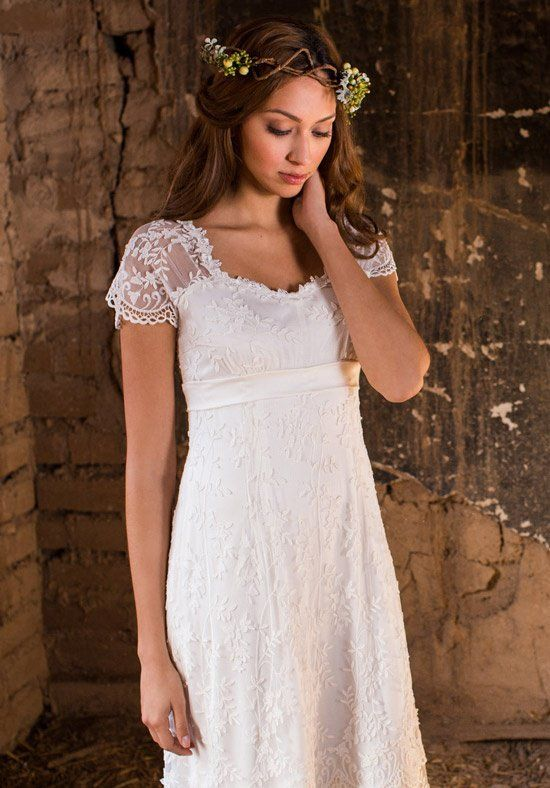 Scalloped embroidered tulle with a leaf-and-vine motif lined with silk charmeuse. Features a side button & loop closure and cap sleeves. Silk charmeuse band at the empire waistline gives this gown a very flattering fit.