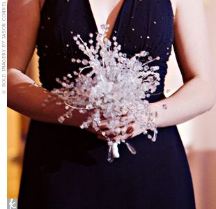 The bridesmaid bouquets of crystal sprays and snowflakes added to Heather's winter wonderland vision.