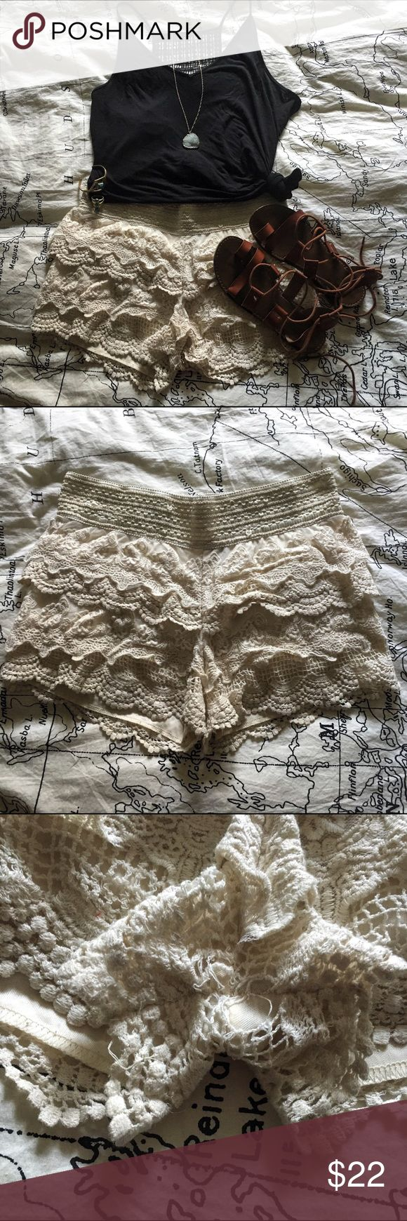 Cream Lace Shorts These lace shorts are cute, flirty, and perfect for summer. They are a gorgeous off white color, made with layers of beautiful lace that create a classy design. They have a layer of cream fabric to prevent them from being see through, however still wear light colored under garments so that nothing can be seen. There is a small hole of lace coming undone in the crotch area. Due to location and size it isn't very noticeable. Besides this only worn a few times and in great…