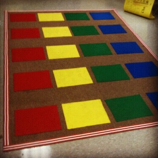 Save $$$! Give your old classroom carpet a makeover by using felt squares. Only 20 cents a piece! I also outlined it with ribbon :)