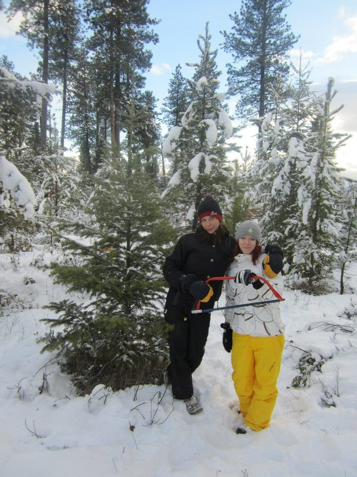 Student and hostmom cutting down their own Christmas tree