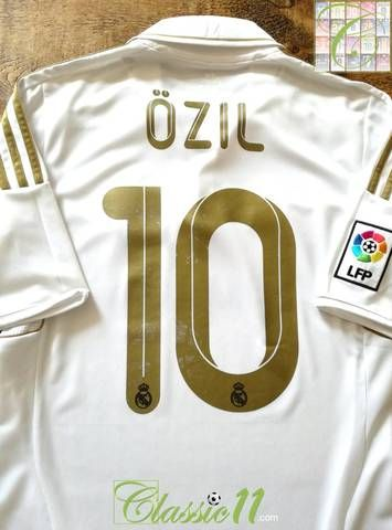 f5fe71aa0 Official Adidas Real Madrid home football shirt from the 2011 12 season.  Complete with Özil  10 on the back of the jersey and La Liga patch on the  sleeve.