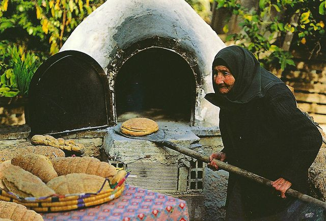 Greece - Woman Baking Bread Outdoor Wood Burning Oven This lady looks amazing! I wonder how many loaves she has made in her lifetime. Postmarked in 2011 with two Greece (Hellas) stamps featuring a blue set of stairs with a red circle