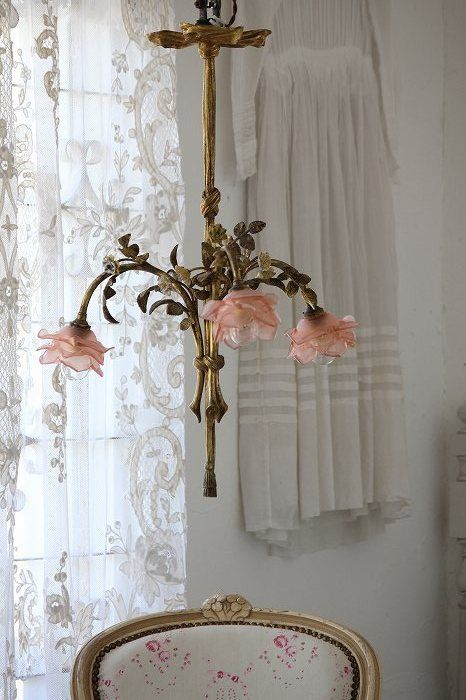 Antique, French, shabby chic chandelier of beautiful Roses