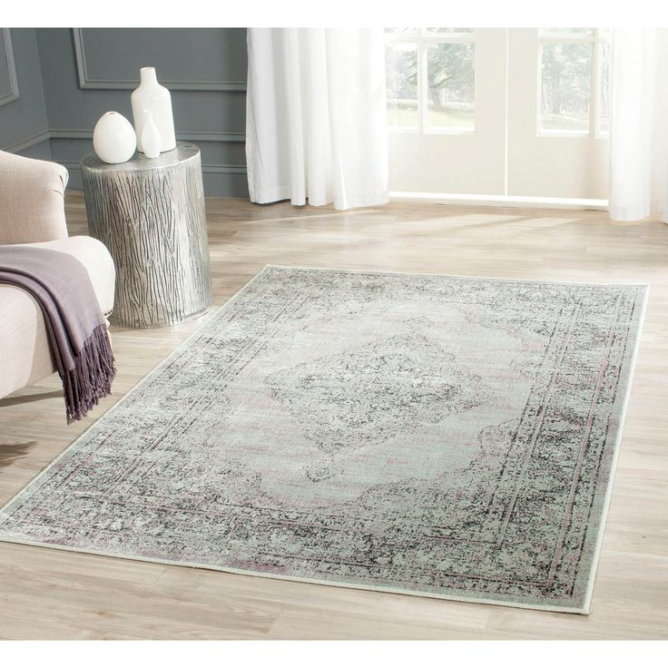 Step back in time with this romantic shabby chic Vintage rug by Safavieh. As part of Safavieh's Vintage collection, this rug wholeheartedly embodies old-world charm.