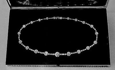 """In 1947, Princess Elizabeth turned 21 years old while in South Africa. The country of Rhodesia gifted her a diamond flame lily brooch. In South Africa, they gave her a very  impressive diamond necklace, with 21 large diamonds, the largest of which was 10 carats. The larger diamonds were separated by groups of a baguette diamond to form a long necklace. From that day on, she has referred to the South African set as """"my best diamonds""""."""