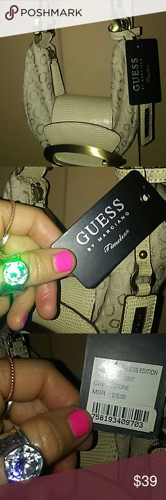 NWT Guess stone/gold logo mini shoulder bag NWT Guess stone/gold logo mini shoulder bag. Retails for $79 as shown on tag in pic #3. Guess Bags Mini Bags