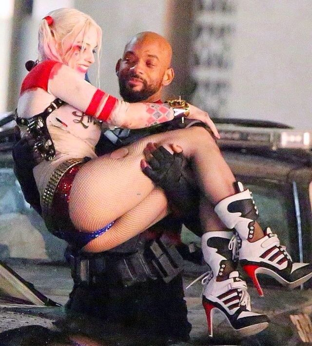 Margot Robbie as Harley Quinn and Will Smith as Dead Shot in Suicide Squad