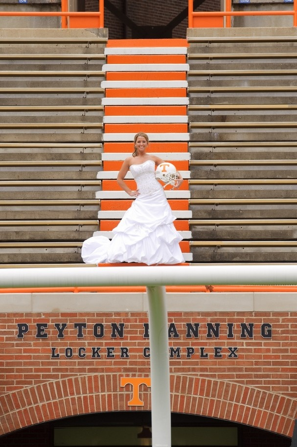 Megan McGlothlin poses behind a goal post at Neyland Stadium as part of her Vol-themed bridal photo shoot. She surprised husband Matt, a former Vol football player, with the photos.