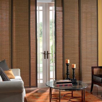 Unique window treatments for sliding glass doors - Panel track blinds for doors - hanging panels. They are very wide and lie flat to the window and slide back and forth in channels.