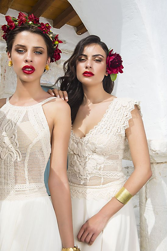 Hellenic Vintage collection. the wedding dresses made of cotton lace with impeccable craftsmanship and unique handmade detailed embroidery.Red flower crown on the heads