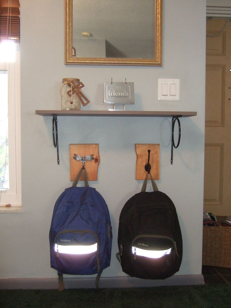 Backpack station: IKEA Hemnes shelf in gray-brown.  Backpack hangers made from pine board remnants (stained) with individual hooks purchased from Lowe's.