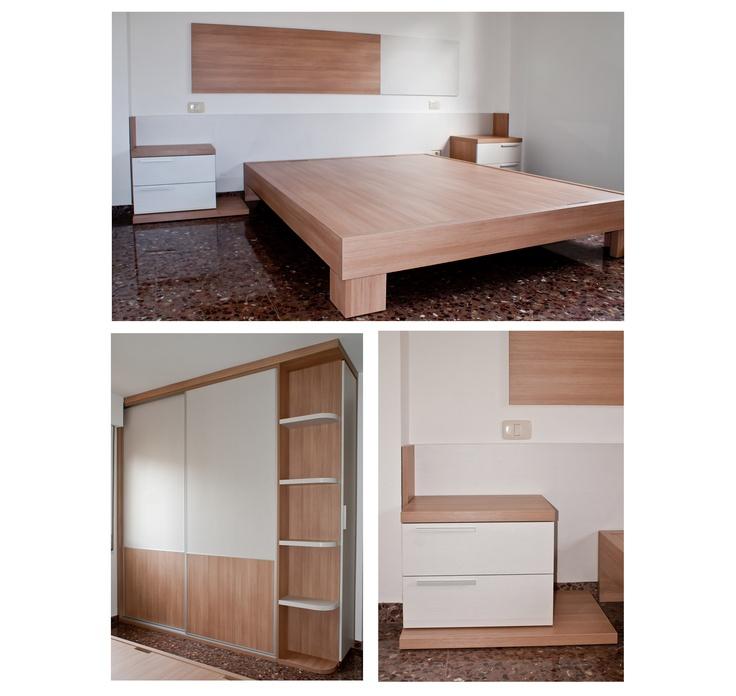 Dormitorio de matrimonio dise ado con una cama ba era de - Puertas correderas colgadas ...