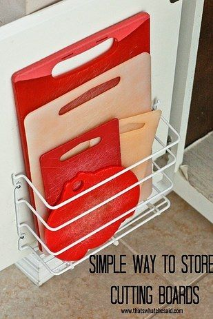 Buy a basic wire rack and some zip ties to keep them on the inside of your cabinet door.