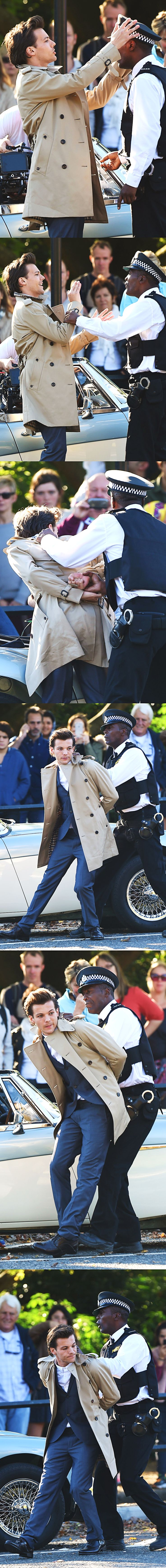 Louis Tomlinson messing with a cop and getting arrested in the Night Changes video