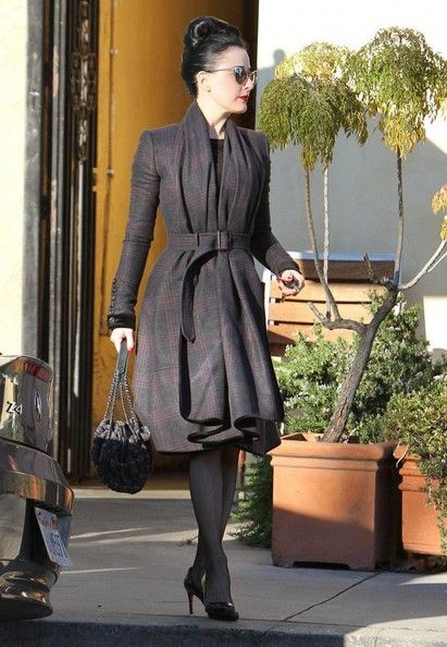 Dita Von Teese in draped wool coat