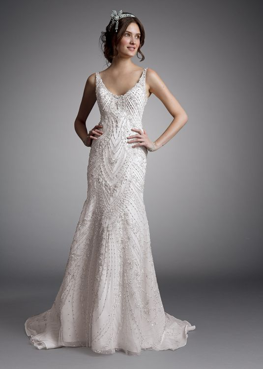 The beading on this Amalia Carrara Collection (Style 333) wedding dress is ethereal and beautiful
