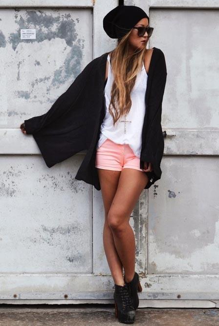 Black kimono style cardigan. White lazy vest. Coral shorts. Boots. Sunglasses. Lazy beanie
