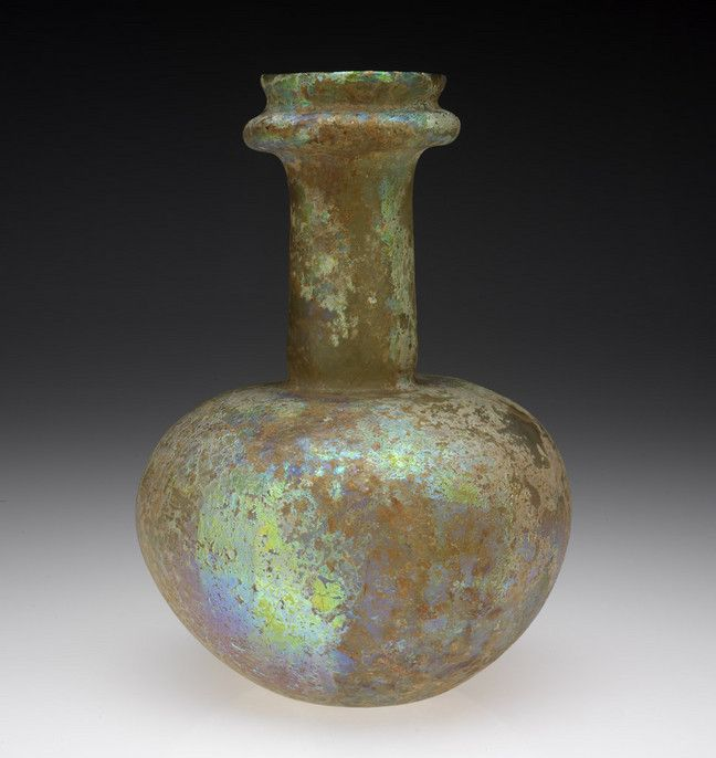 RISD Museum: Unknown artist, Roman. Bottle, 2nd century CE-3rd century CE. Glass, free-blown. 24.4 cm (9 5/8 inches) (height). Gift of Mr. Albert E. Southwick 60.028