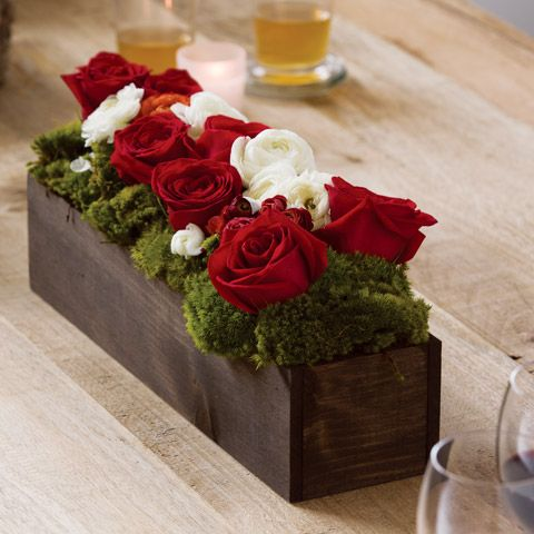 """An abundance of ruffled rouge roses and creamy white and red ranunculus make an elegantly ornate centerpiece. Expertly arranged in a hand crafted wood trough, Blanc & Rouge measures 19"""" x 4"""" x 7"""" - from Olive and Cocoa"""