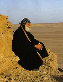 A coptic monk, he lives in a monastery in Egypt.