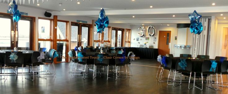 Multi-coloured Blue Organza Chignon style Bows.  Chair Covers were not needed to dress these sleek Black Chairs!    The Sophisticated Touch ...Chair Covers by Design