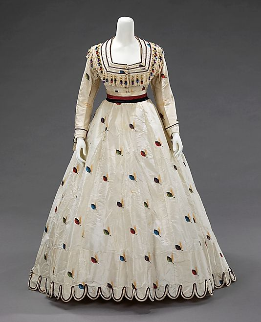 ca 1875. Texier St. Engley. An air of coquettishness and youthful presence inform this set of French dress coordinates. The colorful and spritely decorative details lend a sense of whimsy. The choice of fabric and the inclusion of alternate bodices made this ensemble appropriate for both late day and evening wear.