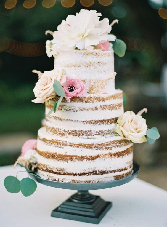 The prettiest floral topped naked cake: http://www.stylemepretty.com/2016/02/25/elegant-blush-gold-al-fresco-wedding/   Photography: Brett Heidebrecht - http://brettheidebrecht.com/: