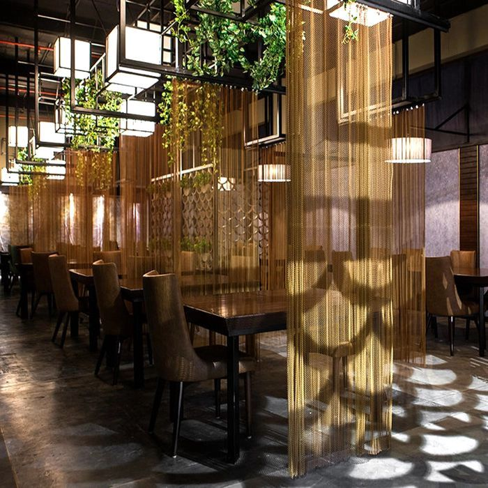 Gold Metal Coil Drapery As Space Divider In A Restaurant Partition Design Restaurant Interior Design Restaurant Design Inspiration
