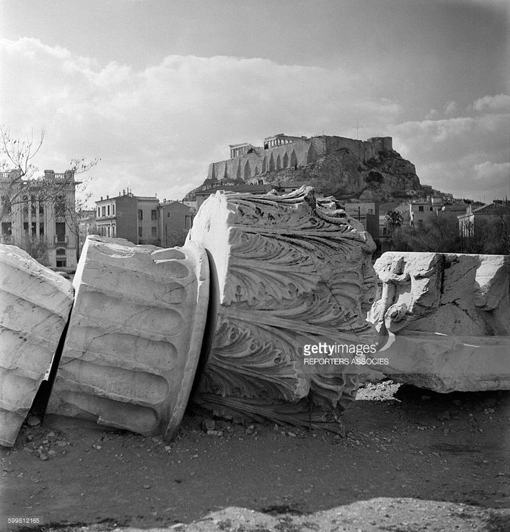 Broken pieces of columns and capitals of Greek Temples on the ground of the Acropolis in Athens, Greece, in 1960 .