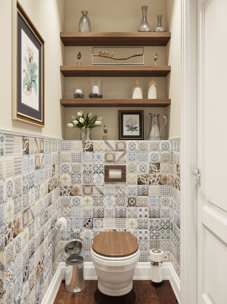 Patchwork tiles have been used to create a feature in this small bathroom. The shelves above the toilet are a nice touch also.
