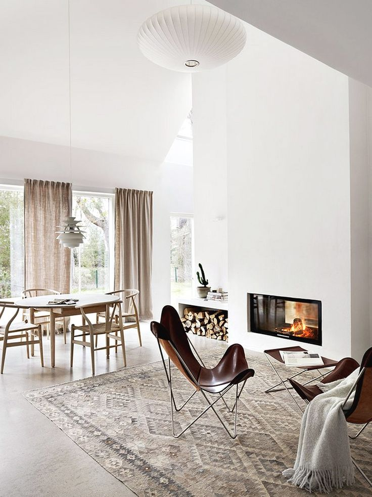 White walls, concrete floor, natural linen curtains and fabrics, neutral tones and natural materials create a soft and harmonious atmospher...