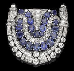 An art deco sapphire and diamond brooch, circa 1930 The openwork shield-shaped…