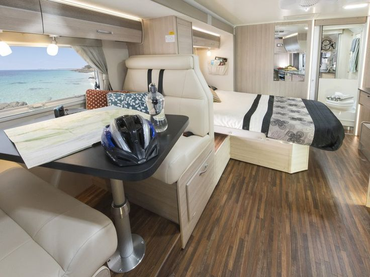 You can see the large size of the slide out room in the C7424SL Birdsville and how it can be opened up whilst parked to increase the living space of the motorhome.
