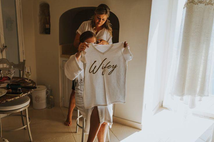 The bride's uniform for the honeymoon. Photo by Benjamin Stuart Photography #weddingphotography #italianwedding #wifey #mrstshirt #weddinggift #bride #bridalprep