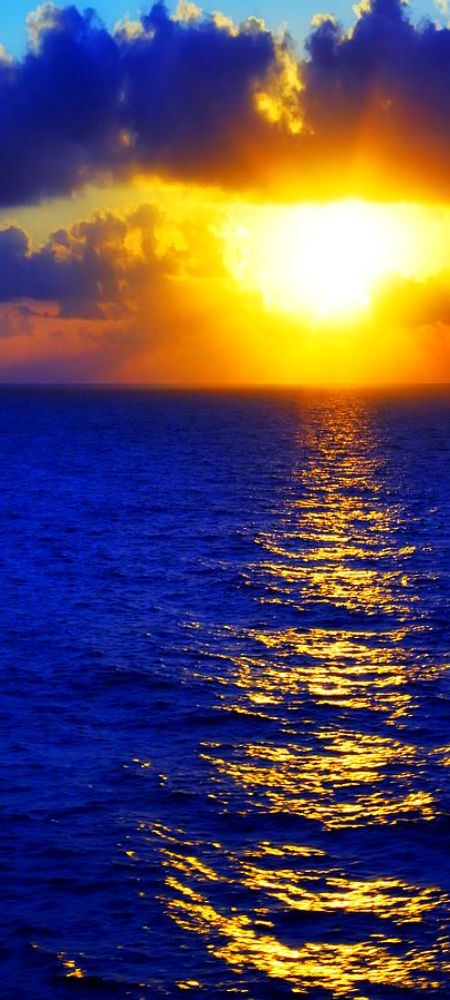 ~ Sunrise over blue ocean ~