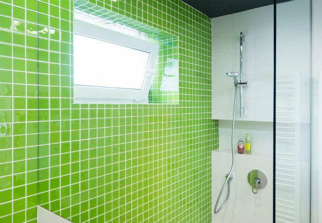 Homemade Shower Cleaner - 4 DIY Recipes - Bob Vila - I just pinned this because I love the color of the bathroom shower tile.