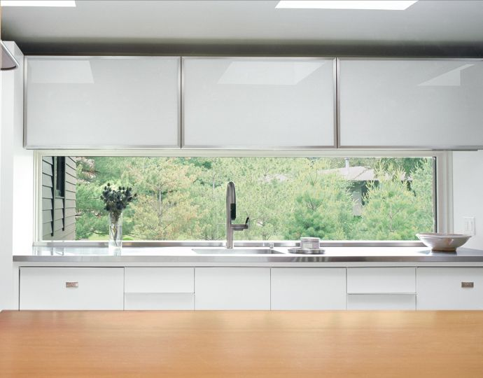 Marvin direct glaze window provides a great view over the kitchen sink.