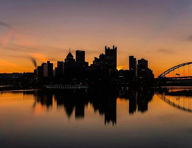 The silhouetted #Pittsburgh skyline reflects in the Ohio River against a backdrop of beautiful colors at dawn